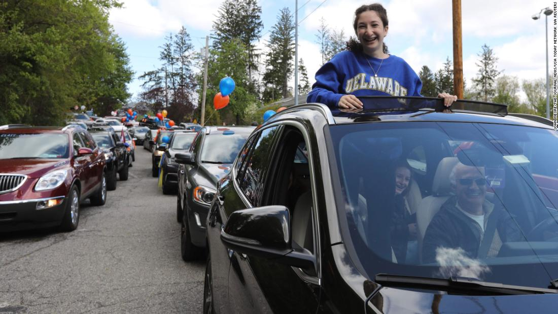A Briarcliff High School student participates in a parade of graduating seniors through Briarcliff Manor, New York, on May 9.