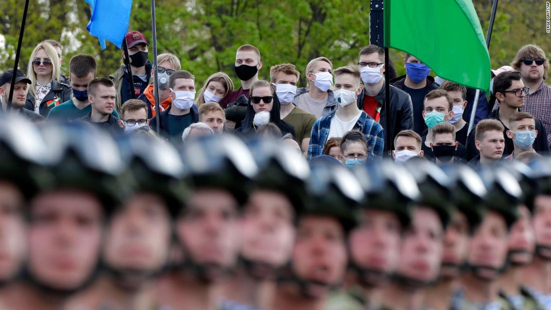 People wear face masks while watching a Victory Day military parade in Minsk, Belarus, on May 9. The parade marked the 75th anniversary of the Allied victory over Nazi Germany in World War II.