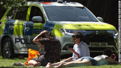 Sunbathers in London in May, during the UK's coronavirus lockdown.
