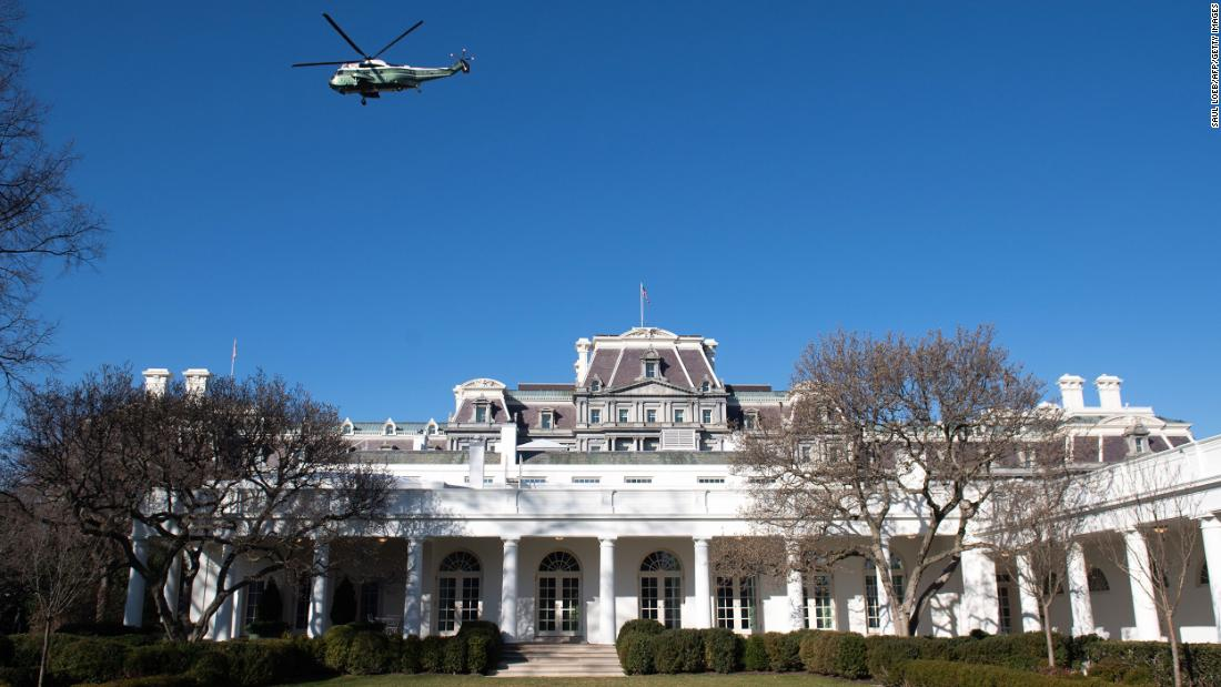 A backup helicopter to Marine One flies over the West Wing and Rose Garden of the White House as US President Donald Trump and First Lady Melania Trump depart the South Lawn in Washington, DC, February 23, 2020, as they leave on a 2-day trip to India. - Trump is heading to India for his first visit there.  United by mistrust of China, Trump's visit will see deals in defence and other areas, including potentially the supply of six nuclear reactors, the fruit of a landmark atomic accord in 2008.The visit will be big on optics, with Modi and Trump appearing at a rally at the world's largest cricket stadium and the US president and First Lady Melania watching the sunset at the Taj Mahal. (Photo by SAUL LOEB / AFP) (Photo by SAUL LOEB/AFP via Getty Images)