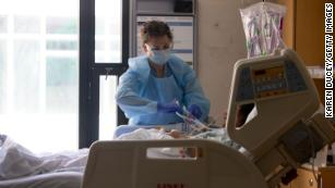 US coronavirus death toll passes 80,000 as states move to phased reopening
