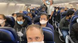 United Airlines said it would try to keep middle seats empty. This photo shows a nearly full flight