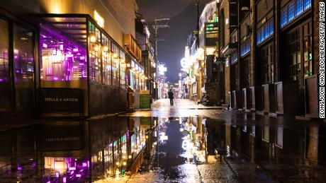 A person walks through the street at night in the Itaewon area of Seoul on Saturday.