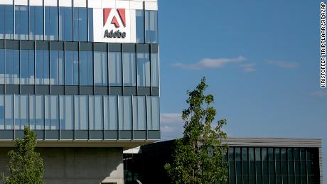 A logo sign outside a facility occupied by software firm Adobe in Lehi, Utah.