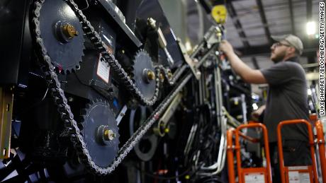 A worker assembles a combine harvester in a production facility in Omaha, Nebraska.