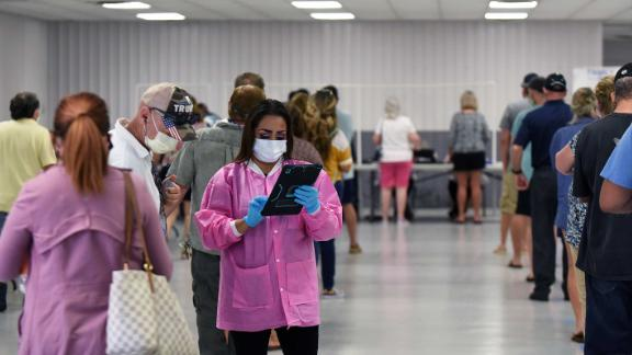 DELAND, UNITED STATES - MAY 4, 2020: A health worker checks people in on the first day of a free COVID-19 antibody testing event at the Volusia County Fairgrounds. After administering 600 tests in several hours, the daily capacity was reached and the site was closed for the day.- PHOTOGRAPH BY Paul Hennessy / Echoes Wire/ Barcroft Studios / Future Publishing (Photo credit should read Paul Hennessy/Echoes WIre/Barcroft Media/Getty Images)