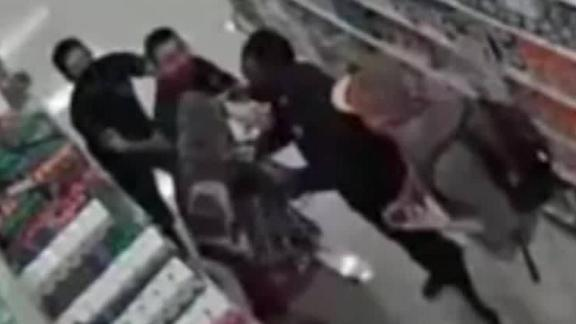 Image for Target employee breaks arm in fight with shoppers who wouldn't wear masks, police say