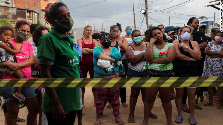Residents wait for food donations organized by NGO Kapadocia Institute for poor families from Capadocia Slum at Brasilandia district amid the coronavirus disease (COVID-19) outbreak, in Sao Paulo, Brazil, May 1, 2020.
