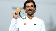 Cancellara poses with one of his two gold medals at the Rio 2016 Olympic Games.