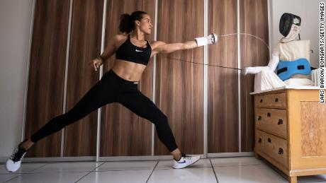 COLOGNE, GERMANY - APRIL 09: German epee fencer Alexandra Ndolo trains with a self made puppet in her apartment on April 09, 2020 in Cologne, Germany. Ndolo normally trains with a coach and team mates, but due to the lockdown she, like many professional athletes, is having to improvising training sessions to stay fit. The Coronavirus (COVID-19) pandemic has spread to many countries across the world, claiming over 70,000 lives and infecting over 1 million people. (Photo by Lars Baron/Bongarts/Getty Images)