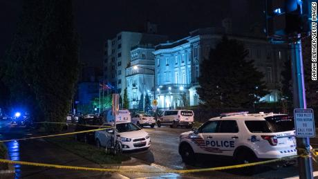Police investigate the scene where a shooter opened fire on the Cuban Embassy on April 30, 2020 in Washington, DC. According to authorities, no injuries have been reported after a gunman used an assault rifle to open fire on the embassy early on Thursday morning.