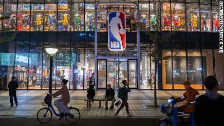 Pedestrians walking by the NBA flagship store in Beijing last October.