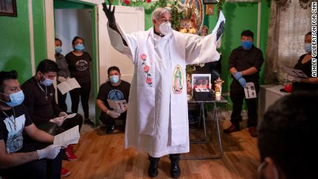 Pastor Fabian Arias, or Padre Fabian, of Saint Peter's Church, conducts a Memorial Mass for Raul Luis Lopez, a delivery person that died of Corona Virus,  in Corona, Queens, on May 9, 2020, during the pandemic in New York. 