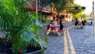 Picnic tables and plants have been added to some streets in downtown Tampa.