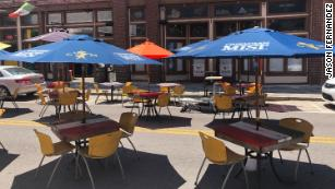 Tampa Bay is allowing some restaurants to place tables in the street so the businesses can remain viable during social distancing. Barricades are placed around the outdoor seating that's now located in the street.