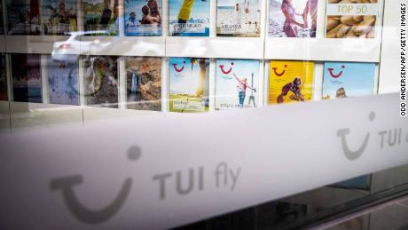 A picture taken on May 13, 2020 through a window shows travel brochures inside a closed branch of the travel firm TUI in Berlin amid the Covid-19 corona virus pandemic. - Tui, the worlds largets travel operator said it would be reopening selected hotels in Germany
