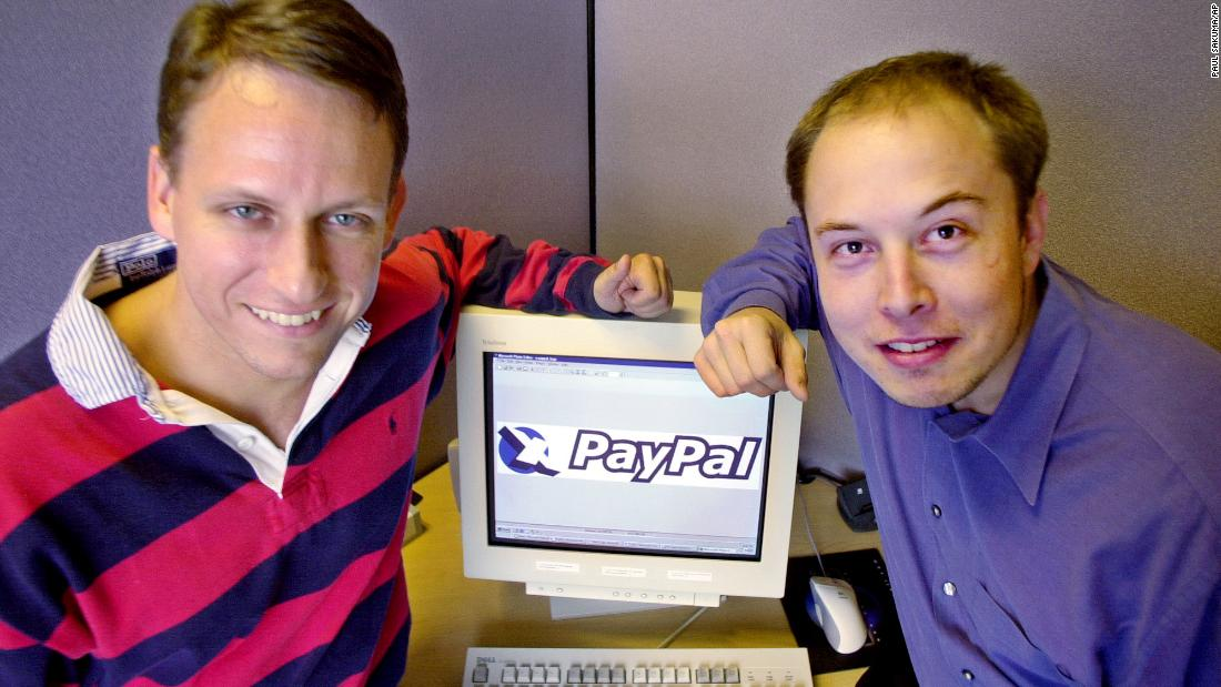 PayPal CEO Peter Thiel, left, and Musk pose at the company's corporate headquarters in Palo Alto, California, in 2000. Musk had co-founded X.com, an online banking and financial services company. It merged with Continuity in 2000 and was renamed PayPal. The online payment platform was acquired by eBay in a $1.5 billion deal in 2002. Musk pocketed $165 million.