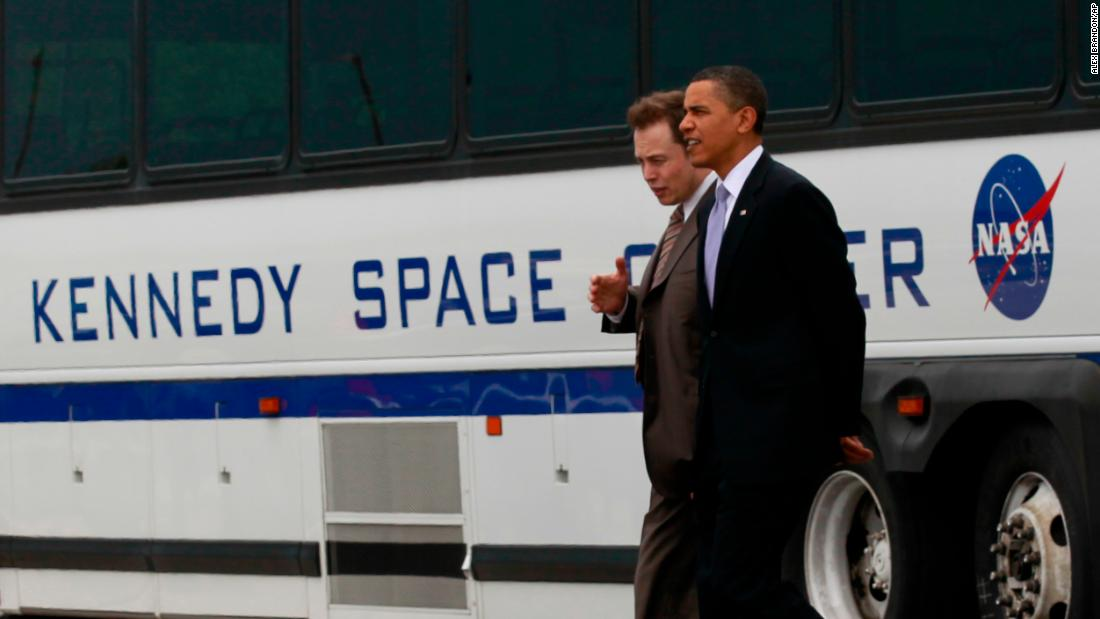 Musk walks with US President Barack Obama at Florida's Kennedy Space Center in 2010.