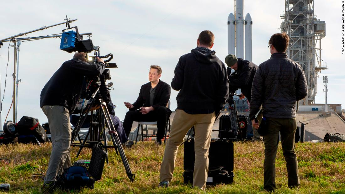 "Musk speaks to reporters in 2018, a day before SpaceX <a href=""https://money.cnn.com/2018/02/06/technology/future/spacex-falcon-heavy-launch-mainbar/index.html"" target=""_blank"">launched the Falcon Heavy,</a> the world's most powerful rocket."
