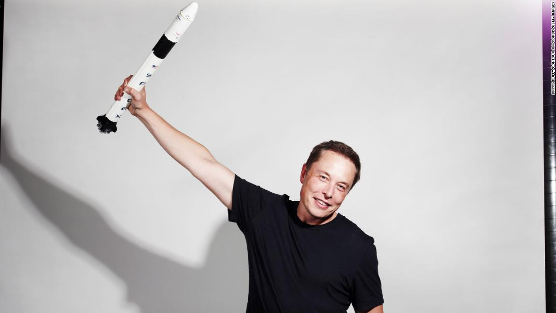 Musk holds up a model rocket in this photo for Bloomberg Businessweek magazine in 2012.