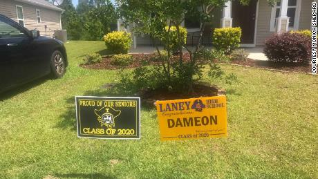 A sign congratulating Dameon Shepard sits on the lawn of the family's home.