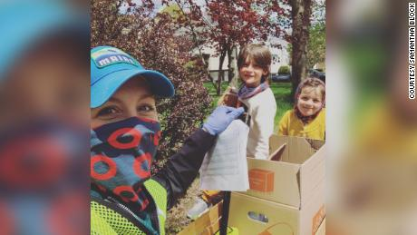 Samantha Block and her children, Levon and Scarlett, were among the dozens of volunteers who helped deliver masks to all the residents of Melrose, Massachusetts, on Tuesday.