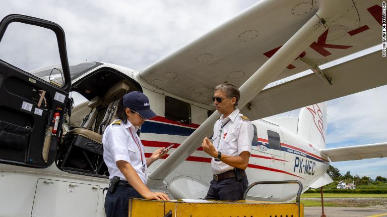 Joyce Lin, left, and fellow pilot Kees Janse prepare for a flight in Wamena, Indonesia.
