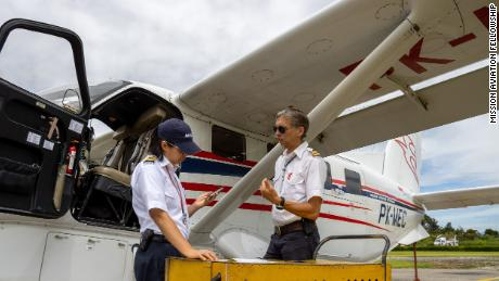 Joyce Lin, left, and fellow pilot Kees Janse prepare for a flight in Wamena, Indonesia.