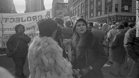 Hundreds protest near Times Square, New York in the wake of President Gerald Ford's speech denying federal assistance to spare New York City from bankruptcy.