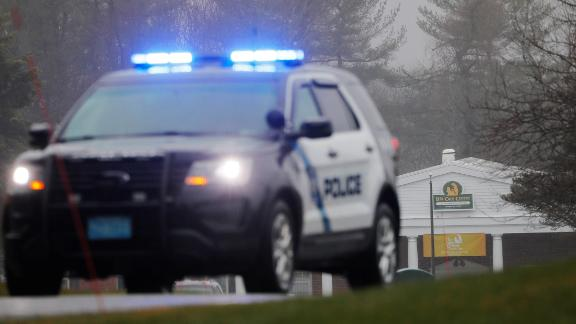 Police guard the entrance of the Life Care Center of Nashoba Valley amid the coronavirus disease (COVID-19) outbreak in Littleton, Massachusetts, U.S., April 3, 2020.   REUTERS/Brian Snyder