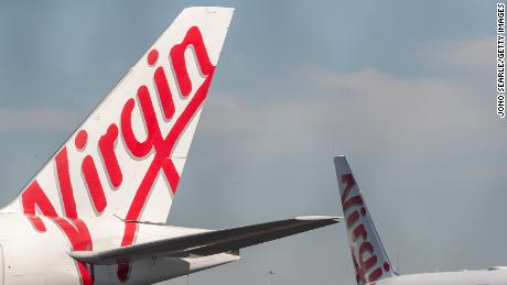 Grounded Virgin planes are seen parked on a tarmac at Brisbane Airport on April 21, 2020 in Brisbane, Australia.