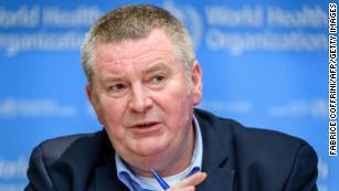 Coronavirus may 'never go away,' says WHO official