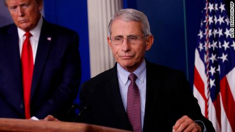 President Donald Trump watches as Dr. Anthony Fauci, director of the National Institute of Allergy and Infectious Diseases, approaches the podium to speak about the coronavirus in the James Brady Press Briefing Room of the White House in Washington DC, on Wednesday, April 22.