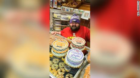 Bill Hanisch poses with graduation cakes at his family's bakery in Red Wing, Minnesota.