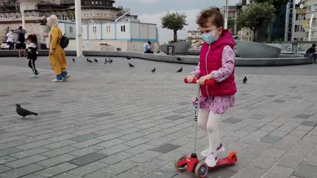child in turkey playing outside