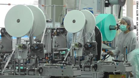 A staff of Taiwans Universal Incorporation, one of the major mask maker, operates machines at a factory in Tainan, southern Taiwan.