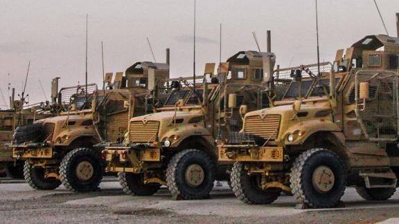 Soldiers assigned to G Company, 2nd Battalion, 14th Infantry Regiment, 10th Mountain Division maintain mine resistant ambush protected vehicles (MRAP) at the maintenance distribution yard on Kandahar Airfield, Afghanistan