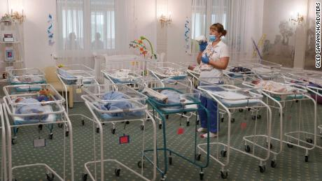 A nurse and newborns in the Hotel Venice in Kiev, Ukraine