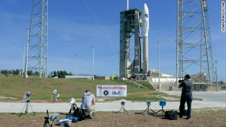 Photographers on Friday set up remote cameras to cover the launch of the Atlas V rocket.