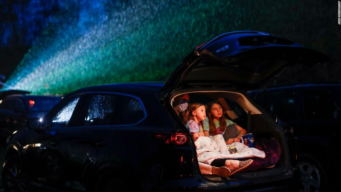 "Guests watch a showing of ""Trolls World Tour"" at the Four Brothers Drive In Theatre, Friday, May 15, 2020, in Amenia, N.Y., during the coronavirus pandemic. (AP Photo/John Minchillo)"