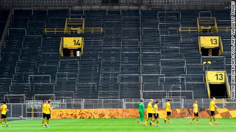 Borussia Dortmund's game against local rival Schalke 04 was played with no fans as soccer returned.