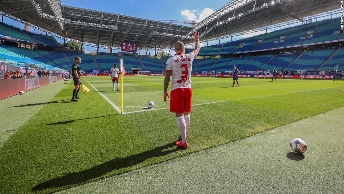 "Angelino, a professional soccer player with the German club RB Leipzig, takes a corner kick during a Bundesliga match against Freiburg on May 16. The stadium was nearly empty, as <a href=""https://www.cnn.com/2020/05/15/football/bundesliga-return-soccer-safety-spt-intl/index.html"" target=""_blank"">no more than 322 people</a> are able to attend each Bundesliga match until the end of the season."