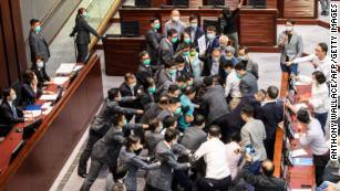 Hong Kong lawmakers scuffle as pro-Beijing politicians clear path for controversial national anthem bill