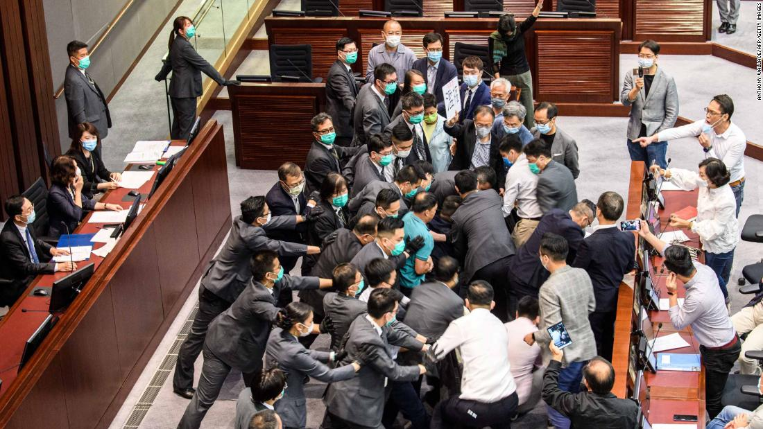 Pro-democracy and pro-Beijing lawmakers scuffle at the House Committee's election of chairpersons on May 18.