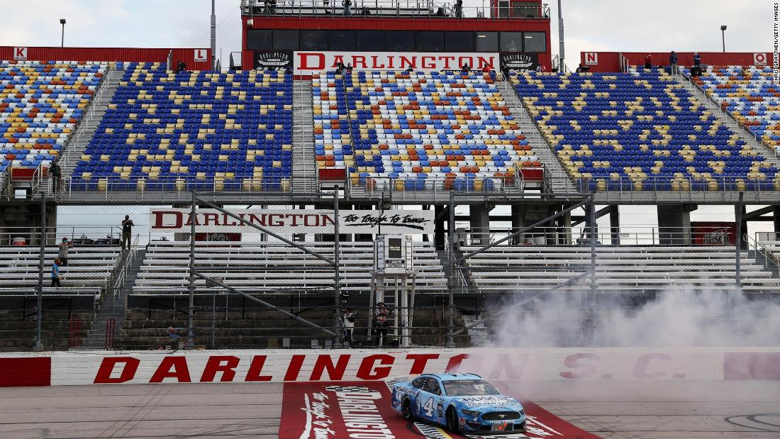 "Kevin Harvick celebrates with a burnout after winning a NASCAR Cup Series race in Darlington, South Carolina, on May 17. It was <a href=""https://www.cnn.com/world/live-news/coronavirus-pandemic-05-17-20-intl/h_e8560781fc2629b4a53f4aa0f0623dee"" target=""_blank"">NASCAR's first race</a> since its season was halted because of the pandemic. No fans were in attendance."