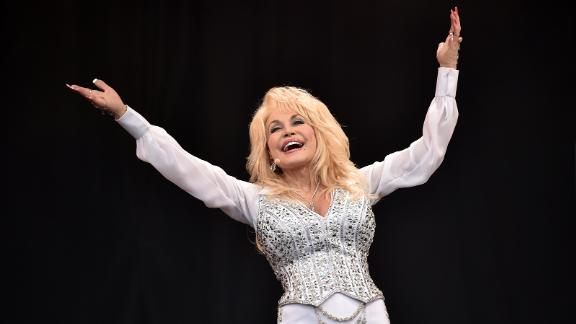 US country music singer Dolly Parton performs on the Pyramid Stage, on the final day of the Glastonbury Festival of Music and Performing Arts on Worthy Farm in Somerset, southwest England, on June 29, 2014.  AFP PHOTO / LEON NEAL        (Photo credit should read LEON NEAL/AFP via Getty Images)