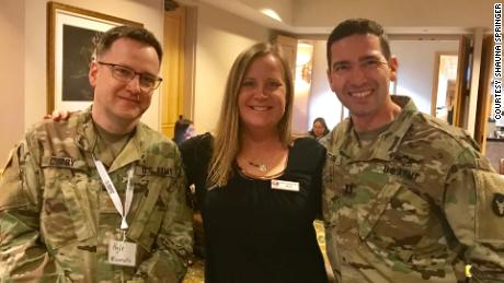 On Springer's left is Eric Strom, a Licensed Clinical Social Worker who is a Behavioral Health Officer in the Army National Guard. On her right is psychologist Kyle Curry, also in the Army National Guard.
