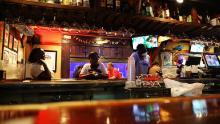 People wait at the bar of a restaurant as the coronavirus disease outbreak continues, in Atlanta, Georgia, U.S., May 15, 2020.