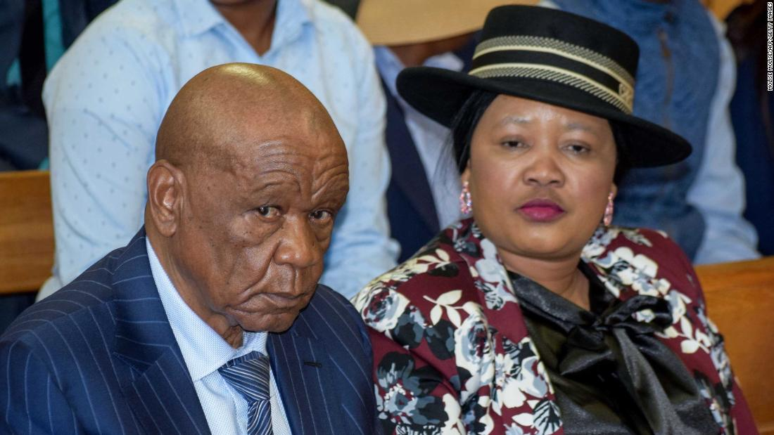 """Prime Minister of Lesotho Tom Thabane (L) and his wife Maesaiah Thabane sit at the Magistrate Court in Maseru, Lesotho, on February 24, 2020. - Lesotho Prime Minister Thomas Thabane on February 25, 2020, lauded himself for """"voluntarily"""" agreeing to resign after he was accused of having a hand in the 2017 murder of his estranged wife. The premier has bowed to pressure to step down and announced July 31 as his official resignation date, citing advanced age. (Photo by MOLISE MOLISE / AFP) (Photo by MOLISE MOLISE/AFP via Getty Images)"""