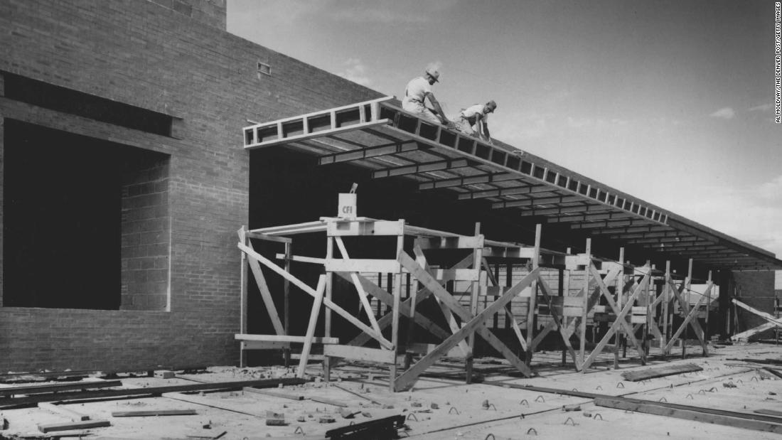 Construction workers build a JCPenney store in Denver in 1956.